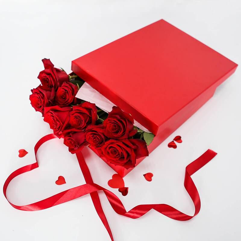 Красные импортные розы в коробке 15 шт.
